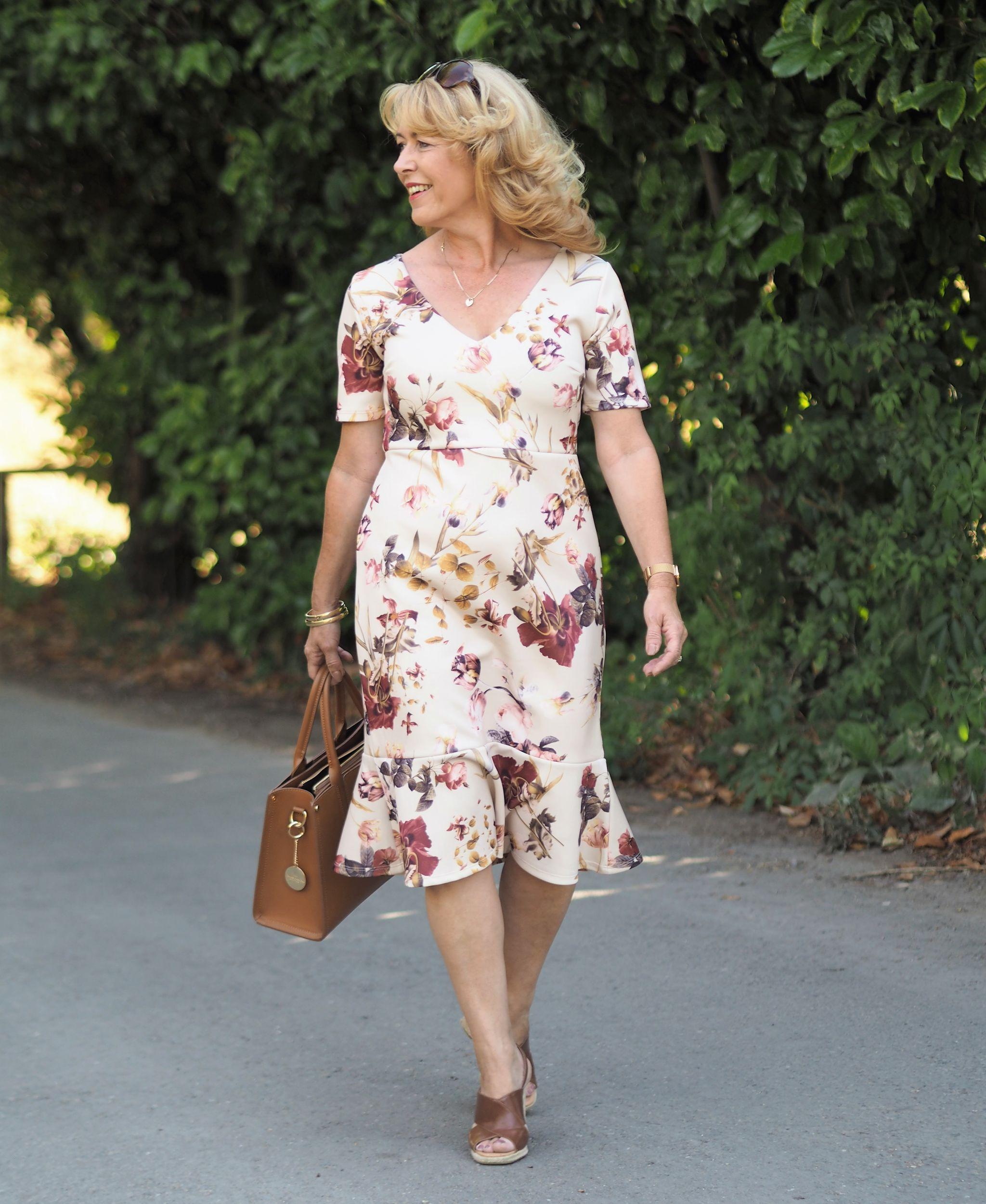 No cardigan or jacket required for our gorgeous warm summer evenings. This floral frill hemmed dress is a real pleasure to wear and when you find out the price of this beauty you will be surprised!